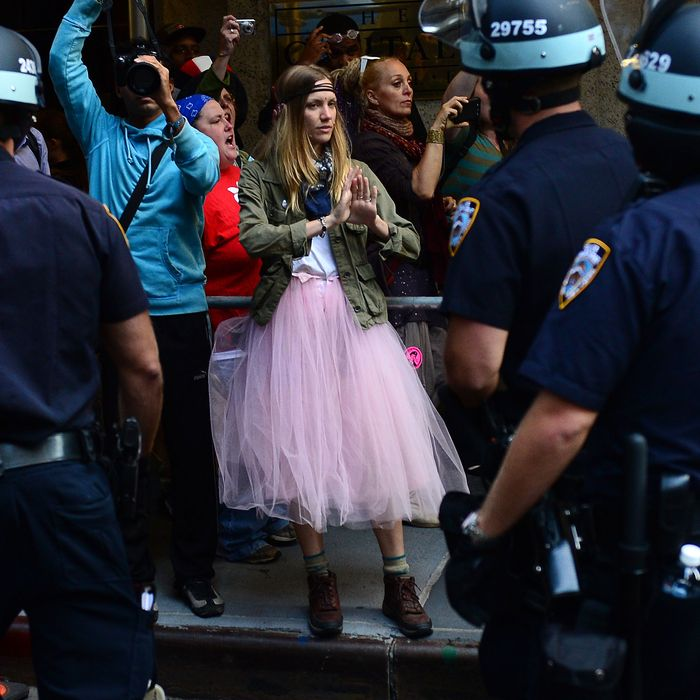 Participants in Occupy Wall Street protest take part in a rally to mark the one year anniversary of the movement in New York, September 17, 2012. Police in New York on Monday arrested at least a dozen demonstrators marking the one-year anniversary of the Occupy Wall Street movement, witnesses said. At least eight people were taken into custody when they tried to block an entrance to Wall Street, representatives of the National Lawyers Guild at the scene, told AFP. Others were arrested when they started moving from Zuccotti Park toward Wall Street as police on horseback blocked side streets on horseback, according to an AFP reporter at the scene. AFP PHOTO/Emmanuel Dunand (Photo credit should read EMMANUEL DUNAND/AFP/GettyImages)