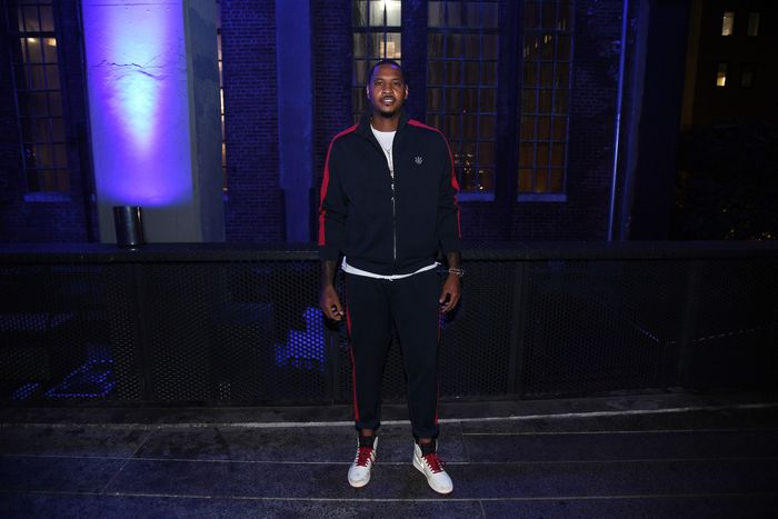 Carmello Anthony, NBA player wearing a navy and red tracksuit