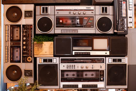 An interactive installation of old boom boxes plays interviews from New York personalities (via headphones).