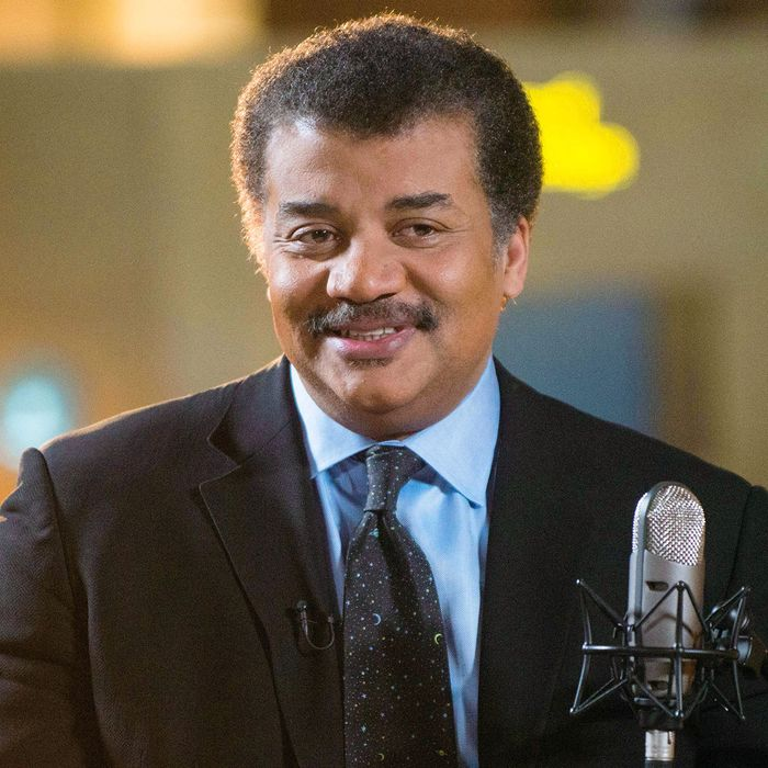 "Neil deGrasse Tyson on the set of his new talk show series ""StarTalk"" filmed with a live studio audience in the Hayden Planetarium at the American Museum of Natural History. ""Star Talk"" premieres on National Geographic Channel in April.(photo credit: National Geographic Channels/Scott Gries)"