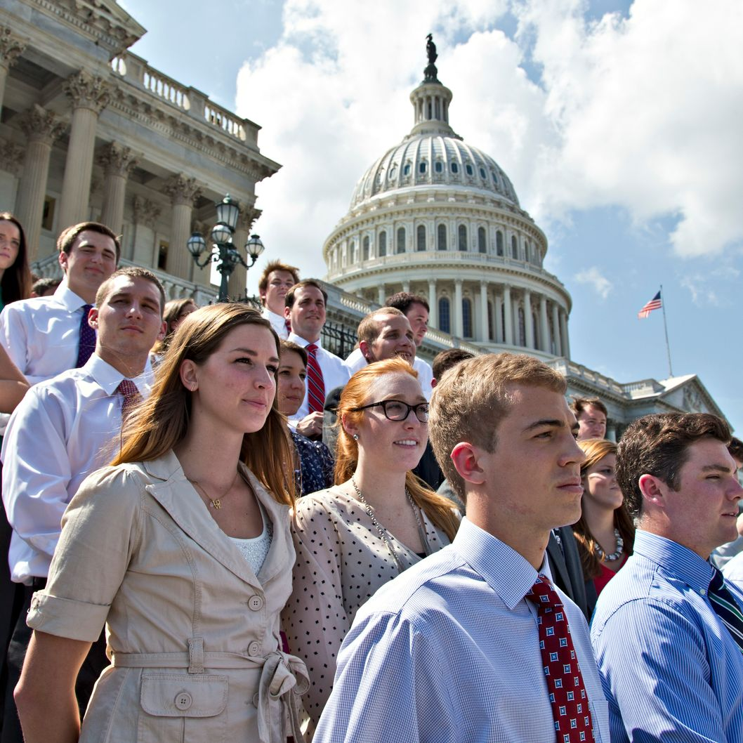 College students wait on the steps of the House of Representatives for Speaker of the House John Boehner, R-Ohio, and GOP leaders to arrive for a news conference on federal student loan rates which doubled on July 1, at the Capitol in Washington, Monday, July 8, 2013. (AP Photo/J. Scott Applewhite)