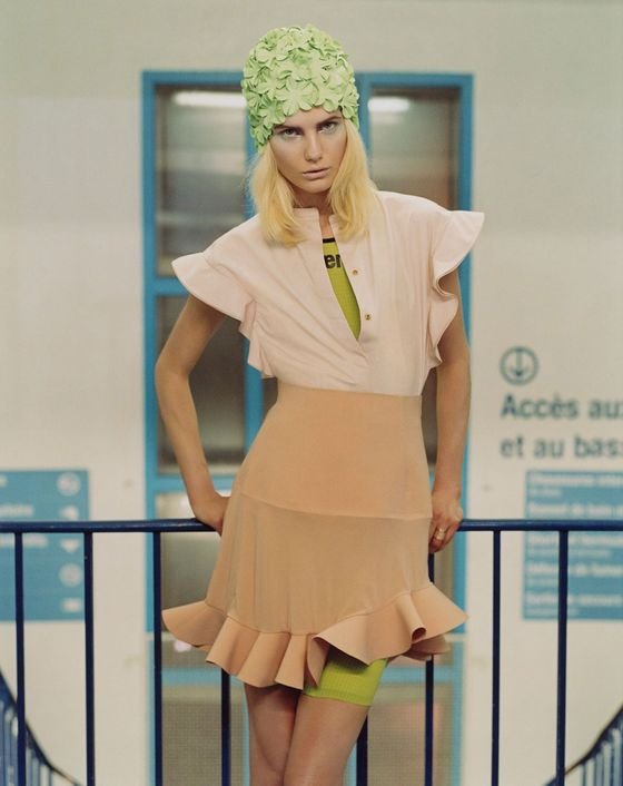 Top and ring, Chloe; skirt, Balenciaga by Nicolas Ghesquière; bodysuit, Arena; swim cap, Headcovers Unlimited.