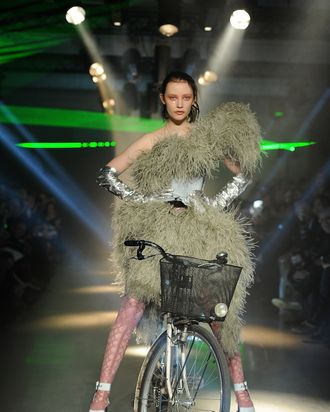 Dempsey Stewart biking through the Vivienne Westwood show.