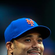 NEW YORK, NY - AUGUST 05:  Johan Santana #57 of the New York Mets looks on from the dugout during the game against the Atlanta Braves at Citi Field on August 5, 2011 in the Flushing neighborhood of the Queens borough of New York City.  (Photo by Chris Trotman/Getty Images)
