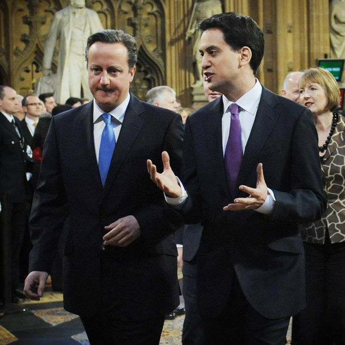 LONDON, ENGLAND - MAY 09: Britain's Prime Minister, David Cameron and opposition Labour Party leader Ed Miliband walk towards the State Opening of Parliament on May 09, 2012 in London, England. Despite opposition from Conservative MPS, the Queen is expected to use her speech to push forward reforms in the House of Lords. Plans to split up banks and change rules on executive pay are also due to be addressed by the government. (Photo by Stefan Rousseau - WPA Pool/Getty Images)
