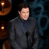 HOLLYWOOD, CA - MARCH 02:  Actor John Travolta speaks onstage during the Oscars at the Dolby Theatre on March 2, 2014 in Hollywood, California.  (Photo by Kevin Winter/Getty Images)