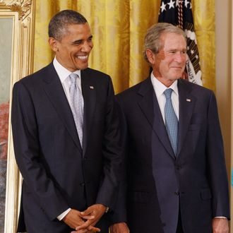 President Barack Obama (L) and former President George W. Bush attend the unveiling ceremony for Bush's offical portrait at the White House