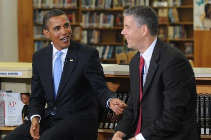 U.S. President Barack Obama (L) and U.S. Education Secretary Arne Duncan host a group discussion with students at Wakefield High School September 8, 2009 in Arlington, Virginia. Obama spoke to students on the first day of the school year, for many in America, encouraging them to study hard and take responsibility for their own education.