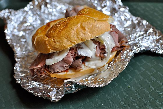 "<b>The Region:</b> Baltimore area  <b>Where to Get It:</b> <a href=""http://www.chapspitbeef.com/"">Chaps Charcoal Restaurant</a>, <a href=""http://smokys-bbq.com/"">Smoky's</a>, <a href=""http://www.urbanspoon.com/r/31/1424408/restaurant/Baltimore/Windsor-Mill-Gwynn-Oak/Pioneer-Pit-Beef-Windsor-Mill"">Pioneer Pit Beef</a>  Dry rubbed brisket or top round that's been slow-roasted on a pit then sliced thin and served on a kaiser roll with raw onion and horseradish mayonnaise — that's the gist of the original And while it may sound like a roast beef sandwich with a fancy name, devoted legions of pit beef fans will be happy to point out just how tricky the real thing is to pull off: Slice thickness is crucial, the rub is clutch, and though it may seem tempting, the addition of anything resembling barbecue sauce absolutely ruins it."