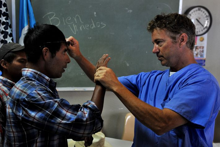 Sen. Rand Paul offered his own glasses to Juan Hernandez (age 29) just to see if it would make a difference as he checked his eyes. (it didn't) Juan Hernandez and his brother Andres Hernandez (age 22) at left were reunited with Paul who operated on them both in 1999 in Kentucky. Senator and ophthalmologist  Dr. Rand Paul (R-KY) joined a medical team from the Univ. of Utah's John A. Moran Eye Center for three of the five days that the event took place in Salam, Guatemala to do pro bono eye care, mostly cataract surgeries and check-ups. Scores of operations were performed by Paul and the team of doctors from Utah at a Lion's Club eye hospital in Salama.