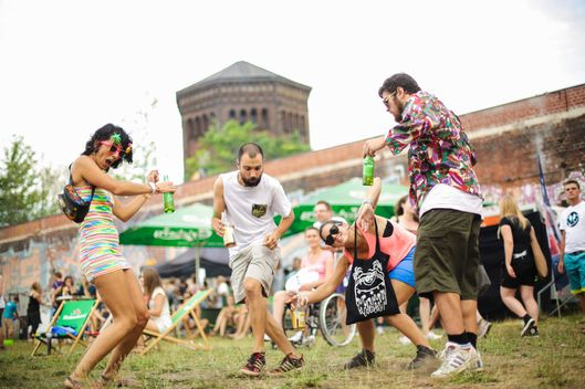 BERLIN, GERMANY - AUGUST 03:  A group of visitors dance on the lawn during the Hipster Cup on August 3, 2013 in Berlin, Germany.  This is the third year for what has now become an annual event. (Photo by Christian Marquardt/Getty Images)