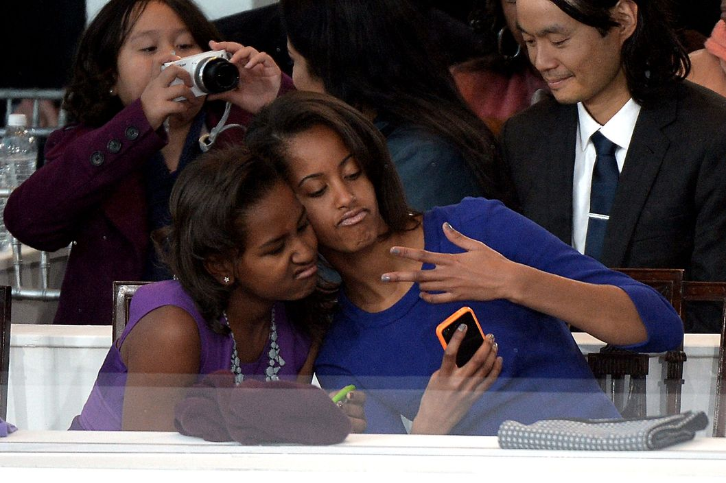 Sasha and Malia take a selfie.