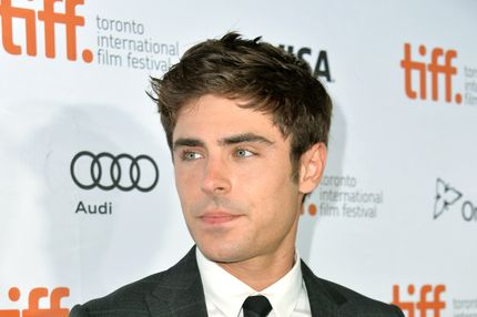 "TORONTO, ON - SEPTEMBER 06:  Actor Zac Efron arrives at the ""Parkland"" premiere during the 2013 Toronto International Film Festival at Roy Thomson Hall on September 6, 2013 in Toronto, Canada.  (Photo by Alberto E. Rodriguez/Getty Images)"