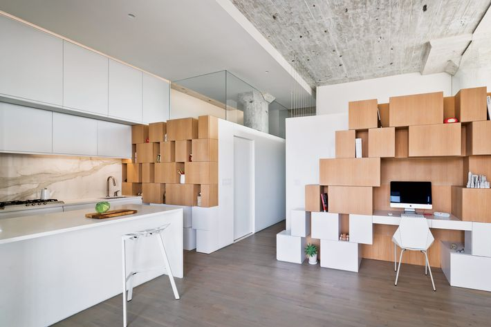 White-oak boxes are set in horizontal bands to elongate the room.