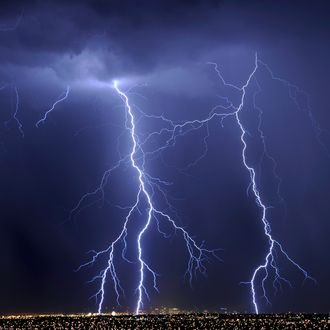 LAS VEGAS, NV - SEPTEMBER 13: Lightning flashes over hotel-casinos in downtown Las Vegas during a thunderstorm early on September 13, 2011 in Las Vegas, Nevada. Stormy weather is expected to continue through Thursday. (Photo by Ethan Miller/Getty Images)