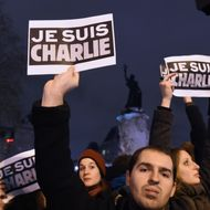 """People hold placards reading in French """"I am Charlie"""" during a gathering at the Place de la Republique (Republic square) in Paris, on January 7, 2015, following an attack by unknown gunmen on the offices of the satirical weekly, Charlie Hebdo. France's Muslim leadership sharply condemned the shooting at the Paris satirical weekly that left at least 12 people dead as a """"barbaric"""" attack and an assault on press freedom and democracy."""