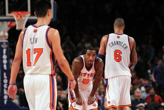 NEW YORK, NY - MARCH 11: J.R. Smith #8 of the New York Knicks stands dejected at the end of the game against the Philadelphia 76ers at Madison Square Garden on March 11, 2012 in New York City. NOTE TO USER: User expressly acknowledges and agrees that, by downloading and or using this Photograph, user is consenting to the terms and conditions of the Getty Images License Agreement.