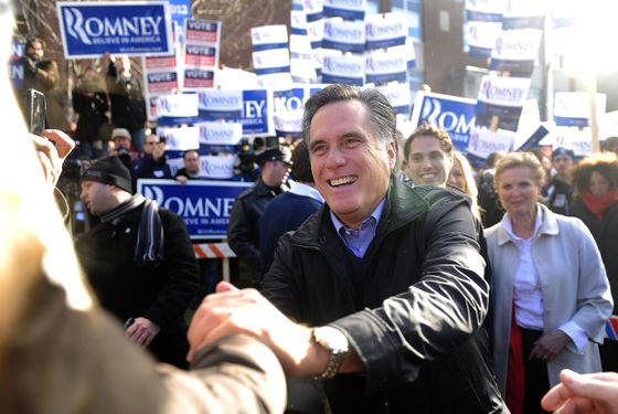 Republican presidential hopeful Mitt Romney greets voters outside a polling station at Webster School in Manchester, New Hampshire, January 10, 2012.  New Hampshire will hold its Republican primary on January 10, 2012.   AFP PHOTO/Emmanuel Dunand (Photo credit should read EMMANUEL DUNAND/AFP/Getty Images)