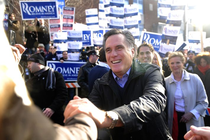 Republican presidential hopeful Mitt Romney greets voters outside a polling station at Webster School in Manchester, New Hampshire, January 10, 2012.