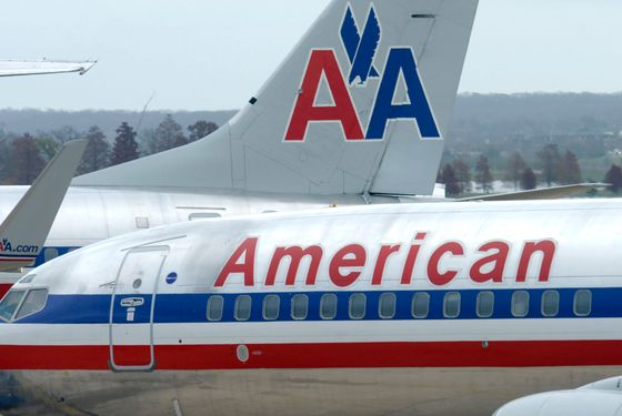 American Airlines planes sit at a gate at Washington's Ronald Reagan National Airport, Tuesday, Nov. 29, 2011. American Airlines and its parent company are filing for bankruptcy protection as they try to cut costs and unload massive debt built up by years of high fuel prices and labor struggles