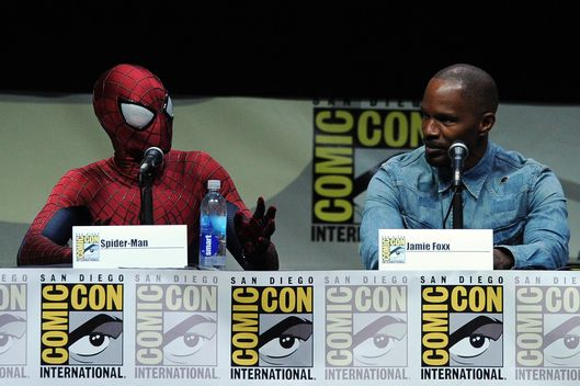 "SAN DIEGO, CA - JULY 19:  Spider-Man (L) and actor Jamie Foxx speak onstage at the Sony and Screen Gems panel for ""The Amazing Spider-Man 2"" during Comic-Con International 2013 at San Diego Convention Center on July 19, 2013 in San Diego, California.  (Photo by Kevin Winter/Getty Images)"