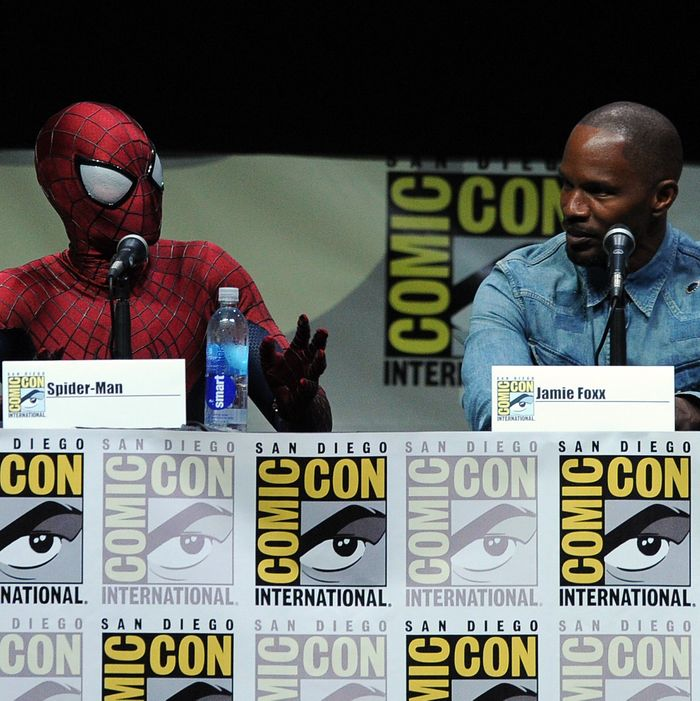 SAN DIEGO, CA - JULY 19: Spider-Man (L) and actor Jamie Foxx speak onstage at the Sony and Screen Gems panel for