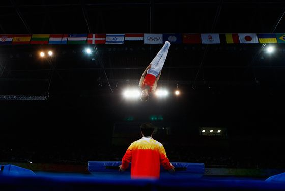 BEIJING - AUGUST 19:  Lu Chunlong of China competes in the men?s trampoline final in the gymnastics event at the National Indoor Stadium on Day 11 of the Beijing 2008 Olympic Games on August 19, 2008 in Beijing, China.  (Photo by Cameron Spencer/Getty Images)