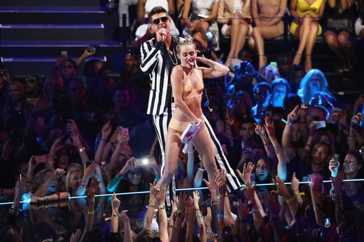 Miley Cyrus and Robin Thicke perform onstage during the 2013 MTV Video Music Awards at the Barclays Center on August 25, 2013 in the Brooklyn borough of New York City.