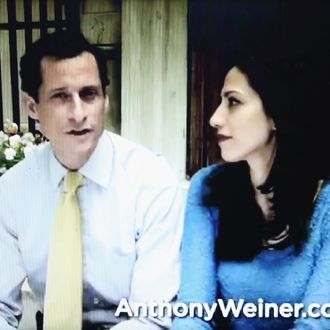 In this photo illustration, former U.S. Rep. Anthony Weiner (L) appears with his wife Huma Abedin in a YouTube video announcing he will enter the New York mayoral race on May 22, 2013 in New York City. Weiner was forced to resign from Congress following the revelation of sexually explicit online behavior.