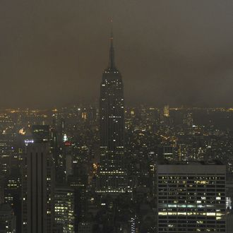 The Empire State Building from the Top of the Rock at Rockefeller Center March 28, 2009 moments after it went dark at 8:30 p.m. as individuals and organizations turn off non-essential lighting for one hour in a call to action for climate change during World Wildlife Fund's Earth Hour 2009.