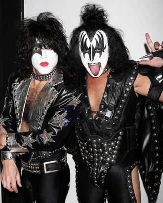 Gene Simmons (R) and Paul Stanley of Kiss pose for a photo backstage during MTV's Total Request Live at the MTV Times Square Studios October 31, 2006 in New York City.
