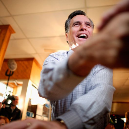 CEDAR FALLS, IA - DECEMBER 29:  Former Massachusetts Governor and Republican presidential candidate Mitt Romney greets supporters during a campaign event at J's Homestyle Cooking December 29, 2011 in Cedar Falls, Iowa. Recent state-wide polls put Romney and fellow candidate Rep. Ron Paul (R-TX) close going into next week's first-in-the-country Iowa Caucuses, a litmus test for the GOP hopefuls.  (Photo by Chip Somodevilla/Getty Images)