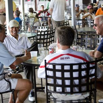 JOINT BASE ANDREWS NAVAL AIR FACILITY, MD - JUNE 18: In this handout image provided by the White House, after playing a round of golf, U.S. President Barack Obama (2L) has a drink with Vice President Joe Biden (R), Speaker of the House John Boehner (L), and Ohio Gov. John Kasich at the clubhouse June 18, 2011 at Joint Base Andrews Naval Air Facility, Maryland. Obama and Boehner edged Vice President Joe Biden and Republican Gov. John Kasich on the 18th hole of the match at a military base outside the capital. The president and the speaker each pocketed a $2 prize. (Photo by Pete Souza/The White House via Getty Images)