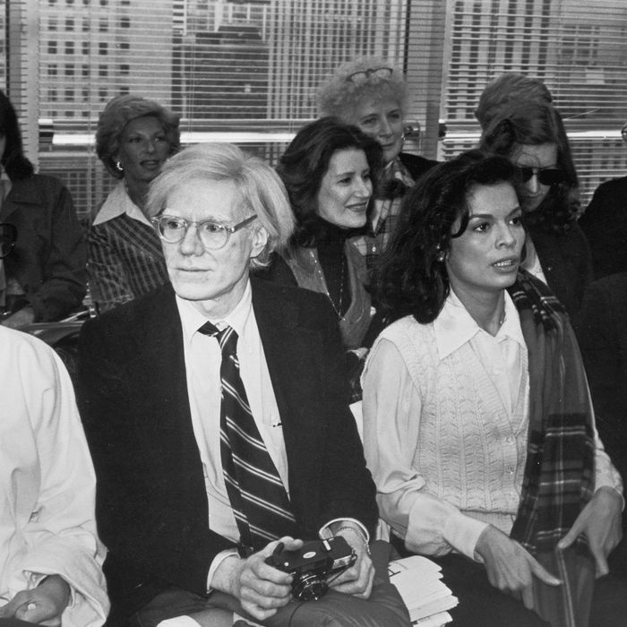 French Vogue editor Françoise de la Renta (nee de Langlade, 1931 - 1983) (left), pop artist Andy Warhol (1928 - 1987) (second left), model Bianca Jagger (second right), and nightclub owner and businessman Steve Rubell (1943 - 1989) attend a fashion show by designer Halston, New York, New York, April 27, 1978. (Photo by Fred W. McDarrah/Getty Images)