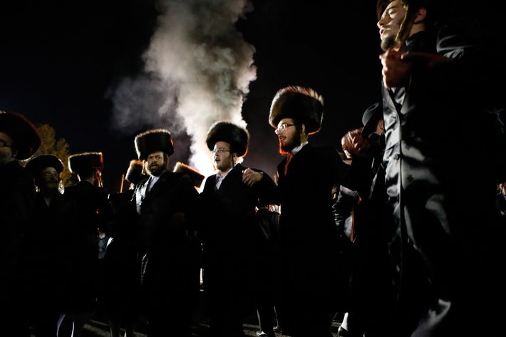 Orthodox Jews of the Satmar Hasidim dance as they celebrate the Jewish holiday of Lag Ba'Omer in the village of Kiryas Joel, New York May 18, 2014. Lag Ba'Omer marks the anniversary of the death of Talmudic sage Rabbi Shimon Bar Yochai approximately 1,900 years ago. Thousands of the Satmar, who are opposed on principle to the existence of the state of Israel, danced near a bonfire into the night.