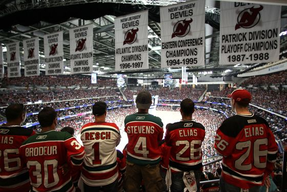 NEWARK, NJ - MAY 30:  New Jersey Devils fans cheer in the stands during Game One of the 2012 NHL Stanley Cup Final against the Los Angeles Kings at the Prudential Center on May 30, 2012 in Newark, New Jersey.  (Photo by Elsa/Getty Images)