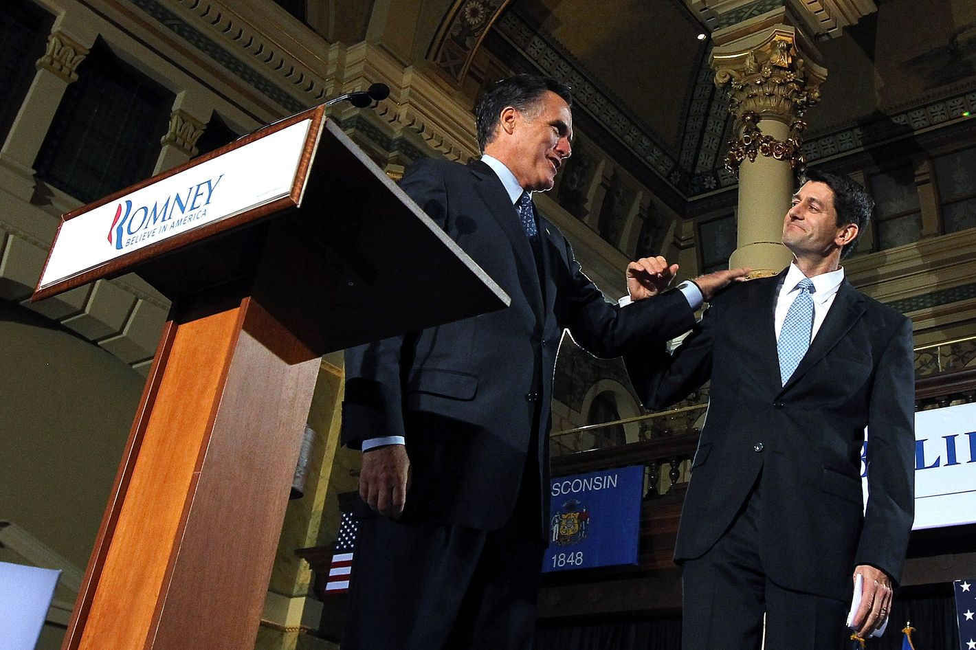 Republican presidential candidate, former Massachusetts Gov. Mitt Romney (L) greets U.S. Rep. Paul Ryan (R-WI) before speaking to supporters during his primary night gathering at The Grain Exchange on April 3, 2012
