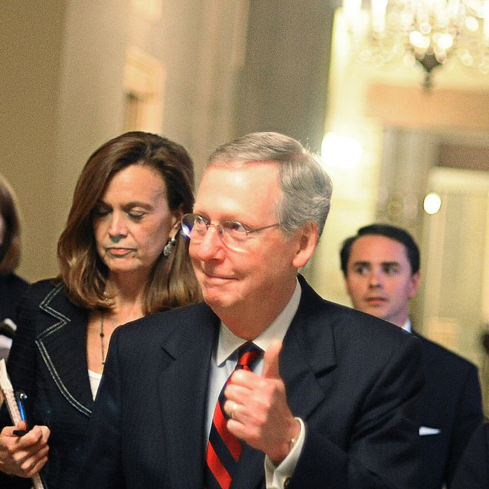 WASHINGTON, DC - JULY 31: (EDITORS NOTE: Retransmission with alternate crop.) U.S. Senate Minority Leader Sen. Mitch McConnell (R-KY) gives a thumbs up when asked whether a deal has been reached regarding the ongoing debate on the national debt reduction on July 31, 2011 in Washington, DC. As the United States approaches the possibility of a default, the congressional leaders and the White House try to reach an agreement on measures to lift the debt ceiling. (Photo by Astrid Riecken/Getty Images)