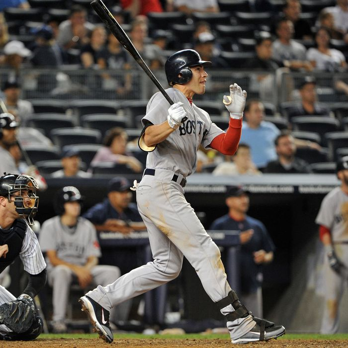 NEW YORK, NY - SEPTEMBER 25: Jacoby Ellsbury #2 of the Boston Red Sox watches his three-run home run in the top of the 14th inning against the New York Yankees on September 25, 2011 at Yankee Stadium in the Bronx borough of New York City. (Photo by Christopher Pasatieri/Getty Images)