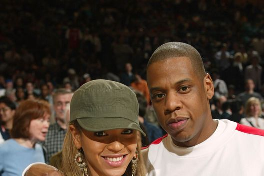NEW YORK - APRIL 11:  Beyonce Knowles and Jay Z poses as the Philadelphia 76ers visit the New York Knicks at Madison Square Garden on April 11, 2003 in New York, New York.  NOTE TO USER: User expressly acknowledges that, by downloading and or using this photograph, User is consenting to the terms and conditions of the Getty Images License agreement.  (Photo by Ray Amati/NBAE via Getty Images)