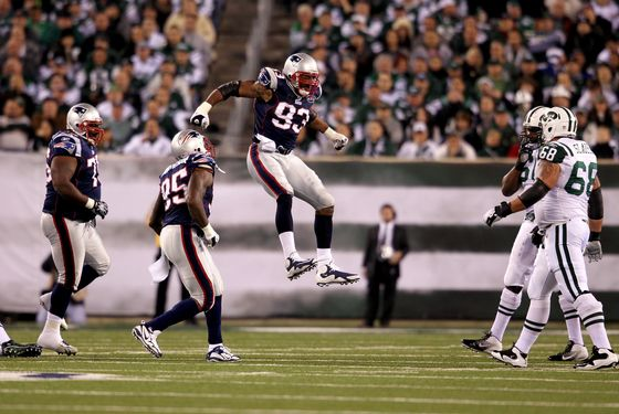 EAST RUTHERFORD, NJ - NOVEMBER 13:   Andre Carter #93 of the New England Patriots celebrates with  Mark Anderson #95 after a sacking  Mark Sanchez #6 of the New York Jets  at MetLife Stadium on November 13, 2011 in East Rutherford, New Jersey.  (Photo by Nick Laham/Getty Images)