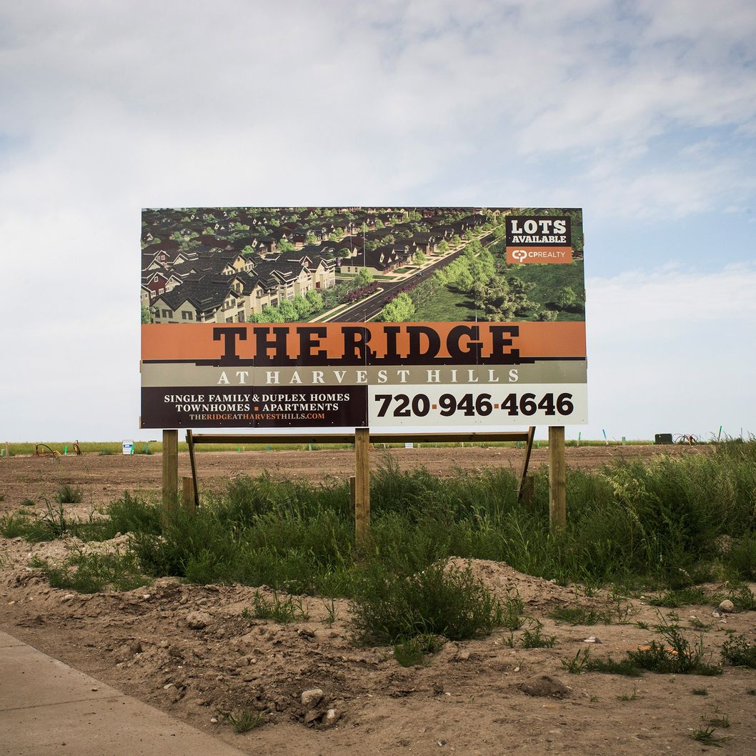 WILLISTON, ND - JULY 28: A sign advertises a new neighborhood on July 28, 2013 in Williston, North Dakota.  North Dakota has been experiencing an oil boom in recent years, due in part to new drilling techniques including hydraulic fracturing and horizontal drilling. In April 2013, The United States Geological Survey released a new study estimating the Bakken formation and surrounding oil fields could yield up to 7.4 billion barrels of oil, doubling their estimate of 2008, which was stated at 3.65 billion barrels of oil. (Photo by Andrew Burton/Getty Images)