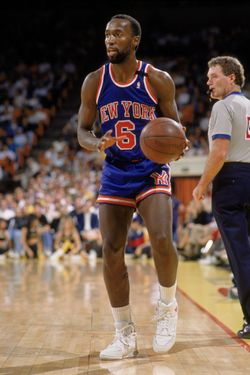 LOS ANGELES - 1989:  Trent Tucker #6 of the New York Knicks holds the ball during an NBA game against the Los Angeles Lakers at the Great Western Forum in Los Angeles, California in 1989.  (Photo by: Mike Powell/Getty Images)