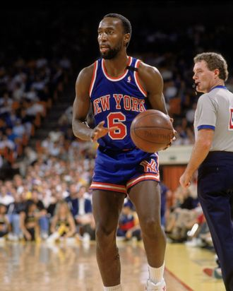 Trent Tucker #6 of the New York Knicks holds the ball during an NBA game against the Los Angeles Lakers in 1989.