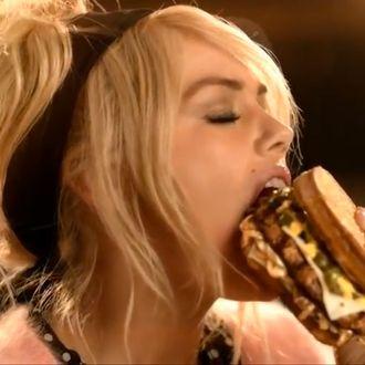 Kate Upton, mid-mouthful.