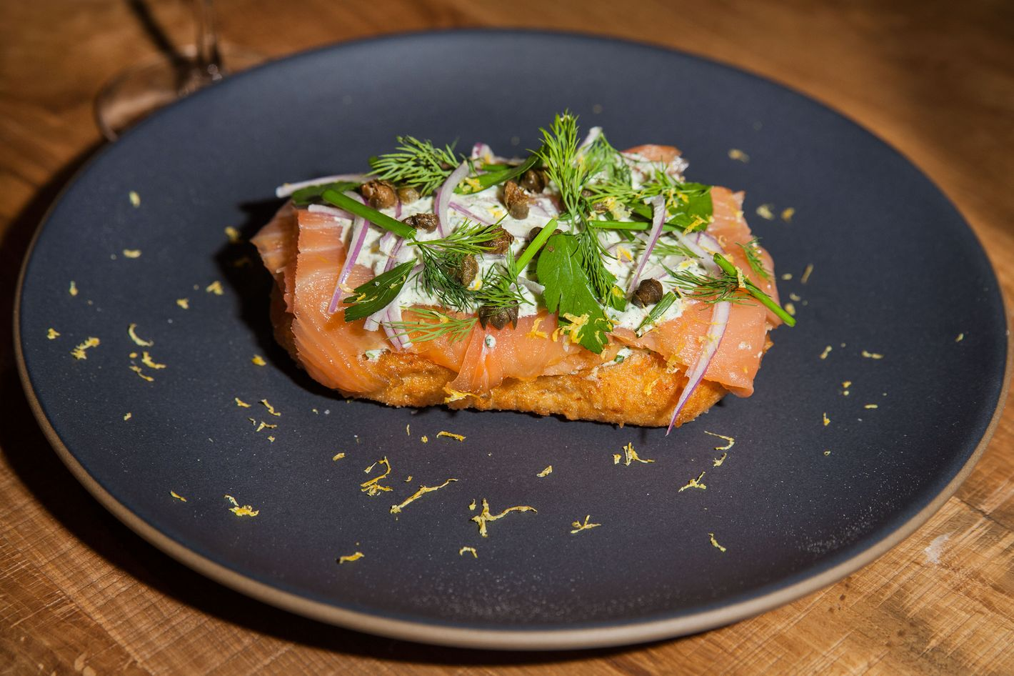 "Lángos, or Hungarian fry bread, is topped with house-smoked salmon and ""ranch"" kefir."