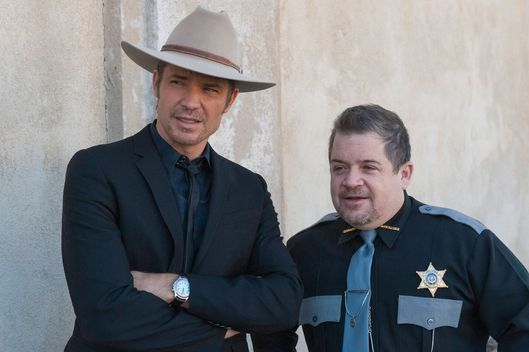 "JUSTIFIED -- ""Sounding"" -- Episode 605 (Airs Tuesday, February 17, 10:00 pm e/p) -- Pictured: (L-R) Timothy Olyphant as Deputy U.S. Marshal Raylan Givens, Patton Oswalt as Constable Bob -- CR: Prashant Gupta/FX"