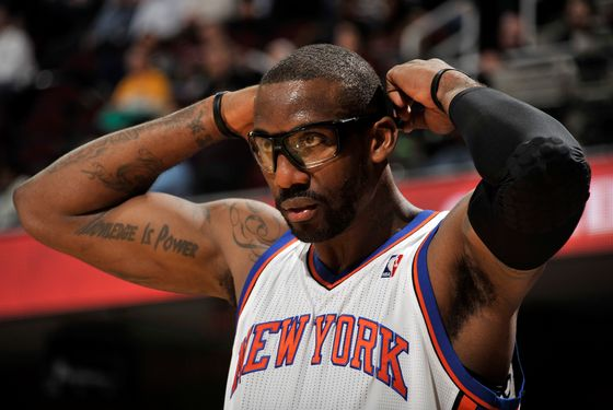 CLEVELAND, OH - JANUARY 25: Amare Stoudemire #1 of the New York Knicks adjusts his glasses during a break in the action against the Cleveland Cavaliers at The Quicken Loans Arena on January 25, 2012 in Cleveland, Ohio. NOTE TO USER: User expressly acknowledges and agrees that, by downloading and/or using this Photograph, user is consenting to the terms and conditions of the Getty Images License Agreement. Mandatory Copyright Notice: Copyright 2012 NBAE (Photo by David Liam Kyle/NBAE via Getty Images)