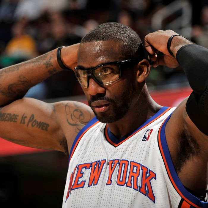 Amare Stoudemire #1 of the New York Knicks adjusts his glasses during a break in the action against the Cleveland Cavaliers at The Quicken Loans Arena on January 25, 2012 in Cleveland, Ohio.