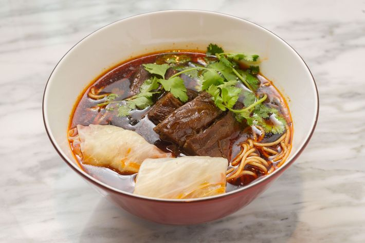 Homemade noodles served in a beef-stock-based soup inspired by Sichuanese-style hot pot.
